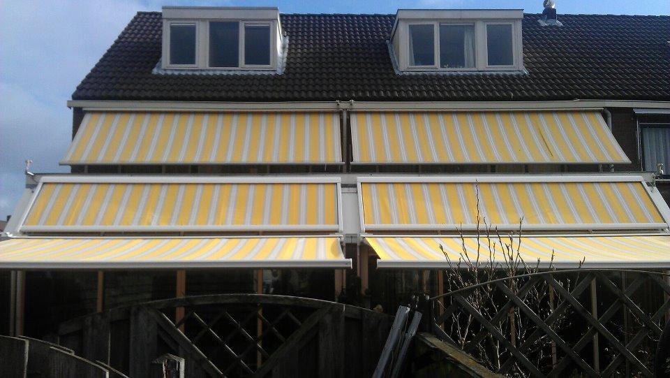 Terrasschermen geel wit gestreept Hennie's Zonwering